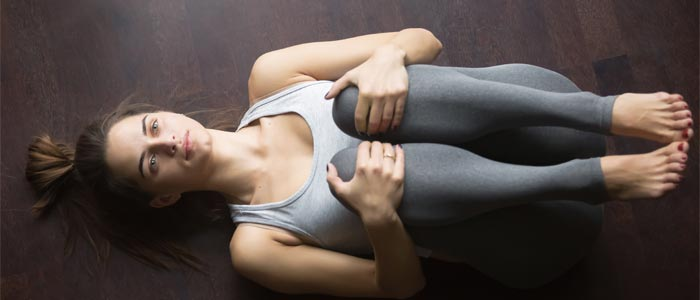 woman doing lower back rotations