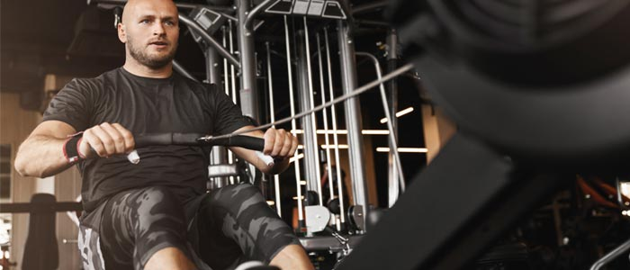 Man training on a rowing machine
