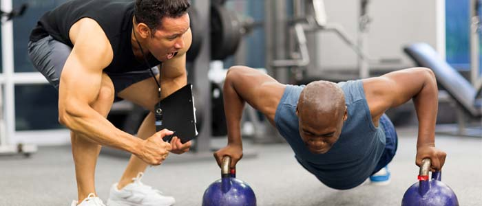 man training with a personal trainer
