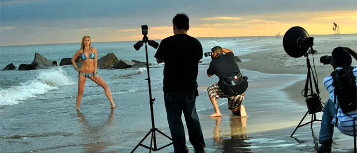 woman being  photographed on the beach