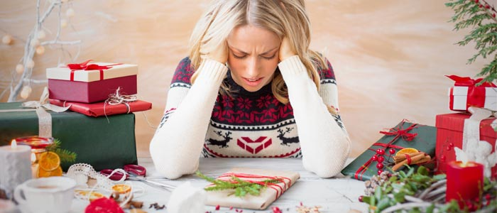 woman stressed over christmas presents