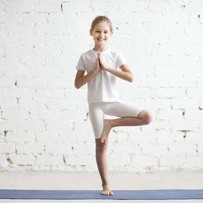 girl doing tree position