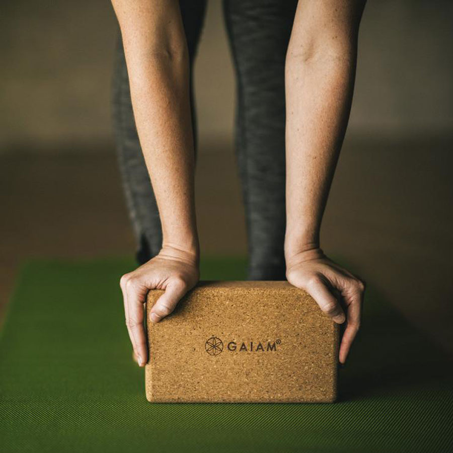 person resting on an eco friendly cork yoga block