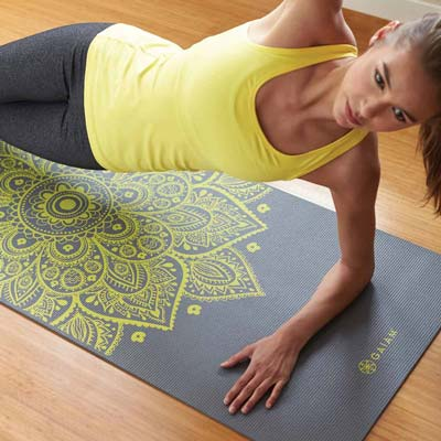 woman exercising on a gaiam mat
