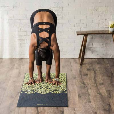 woman bent over on a gaiam mat
