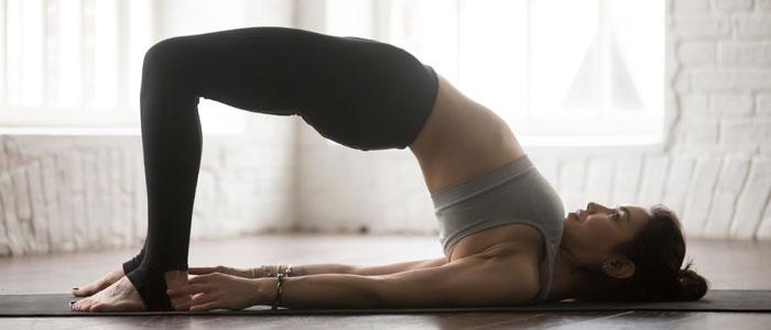 woman doing the bridge yoga pose to help sleep