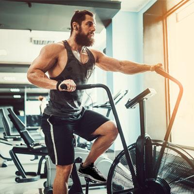 man on an assault exercise bike