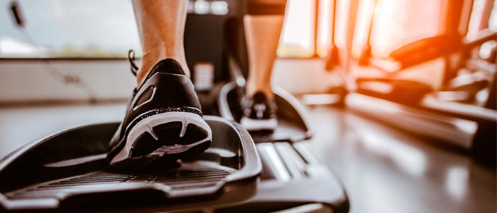 Feet on cross trainer pedals