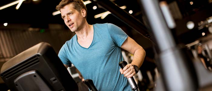 Man on a cross trainer