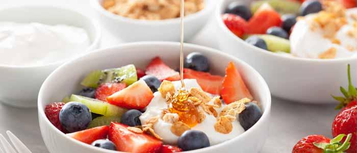 Bowl of fruit (natural sugars) and honey