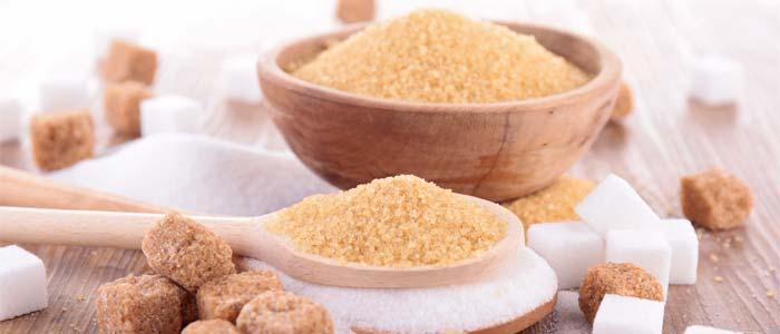 Bowl and spoon of brown sugar