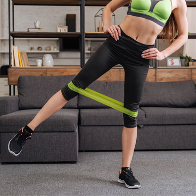 woman doing leg pull aparts with resistance band