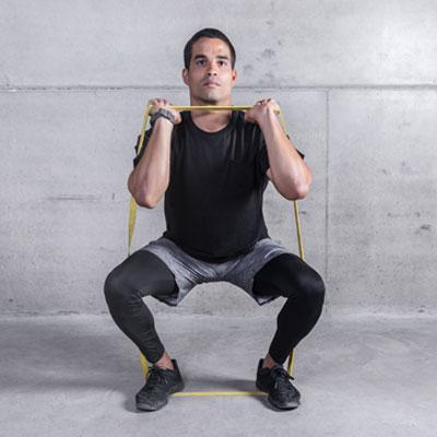 Man doing a resistance band squat
