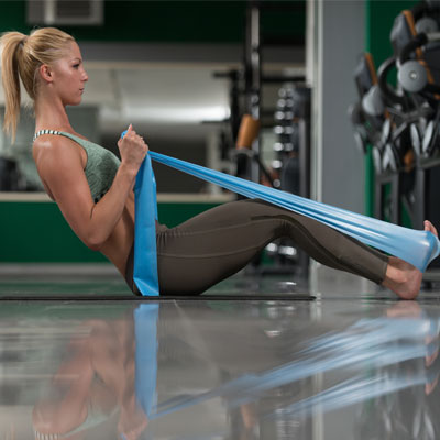 woman doing a leg press with a resistance band