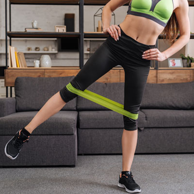 woman doing Standing Leg Raises with a resistance band