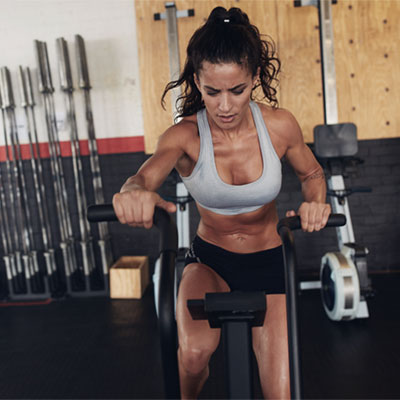 woman in the gym on a bike