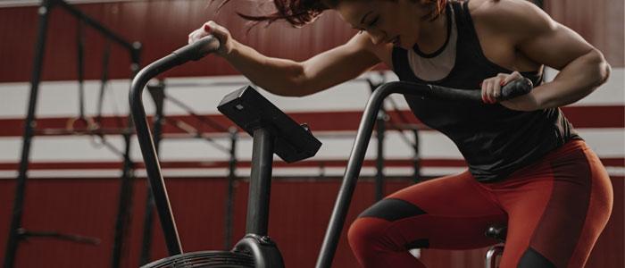 woman training on an assault bike