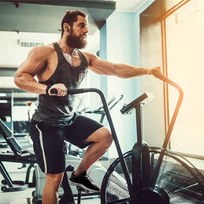 man in the gym on an assault bike