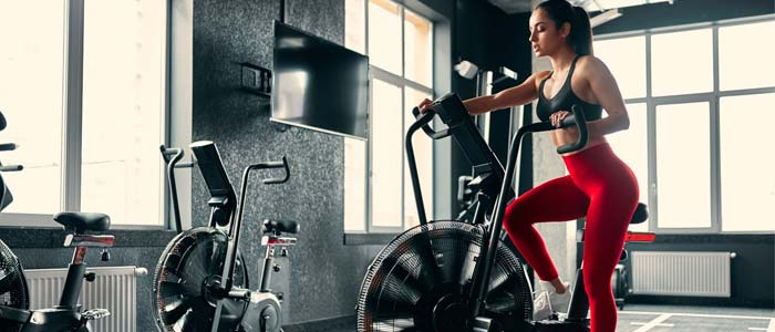 woman in the gym on an assault bike