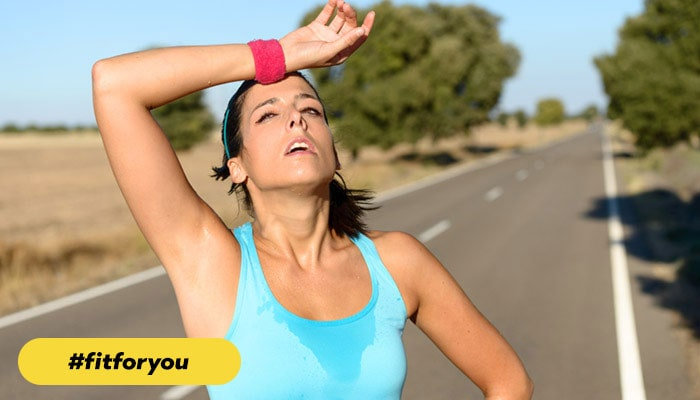 woman outside tired from running #fitforyou