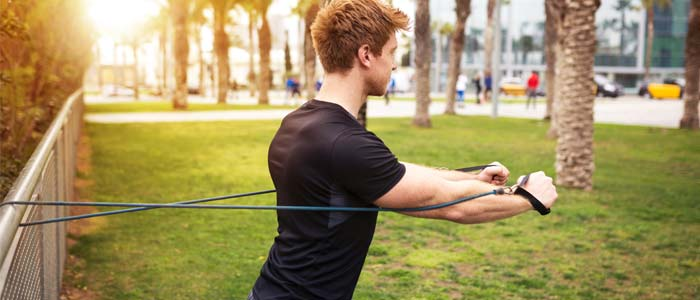 man doing a resistance band chest exercise
