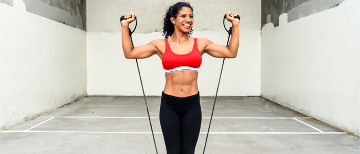 woman doing a resistance band shoulder exercise