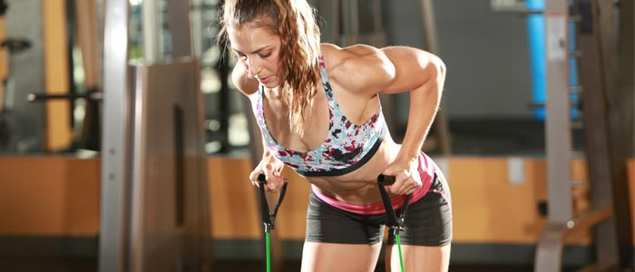 woman doing a resistance band back exercise