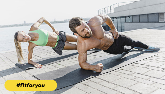 two people doing side push ups #fitforyou