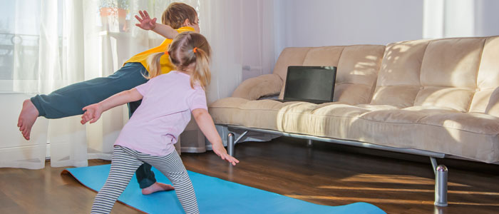 kids exercising to a video on a computer