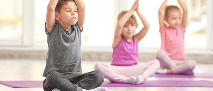 three children doing yoga