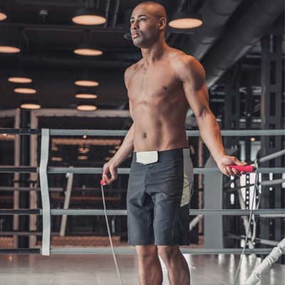 man skipping in a boxing gym