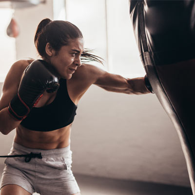 woman punching a heavy bag