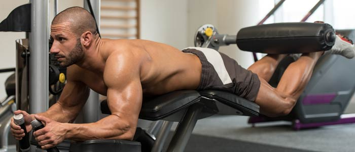 man doing Lying Leg Curls