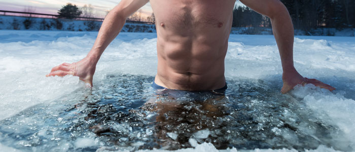 man submerged in an ice bath to aid muscle recovery