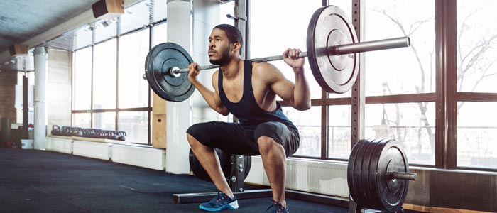 Man doing weighted squats