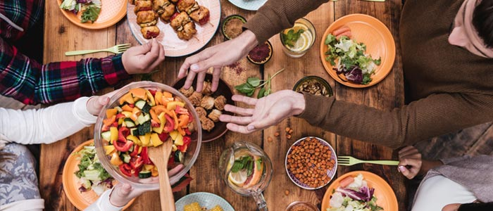 family sharing a table of food