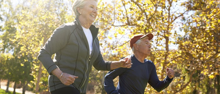 Elderly couple jogging as daily exercise