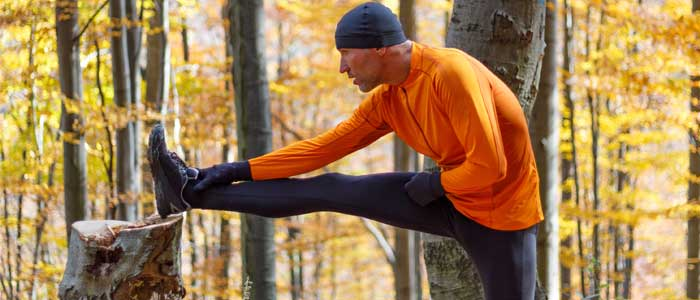 Man outside doing hamstring stretches