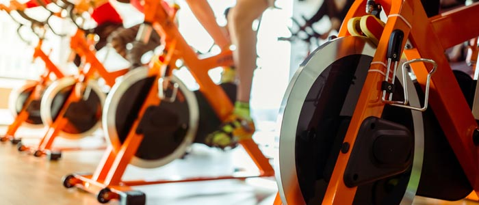 Flywheels of exercise bikes in a gym.