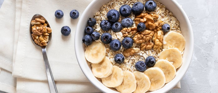 bowl of oatmeal with bananas and blueberries in it