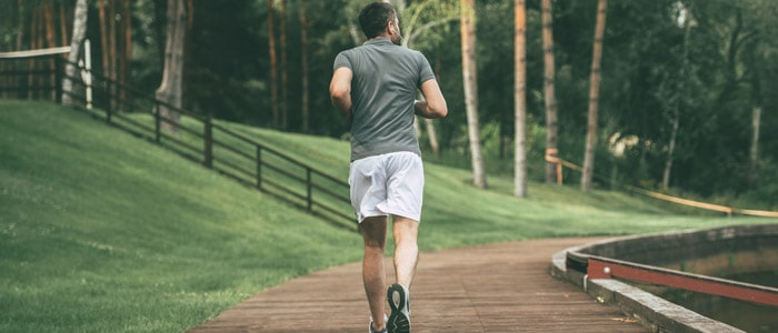man jogging to help manage his stress