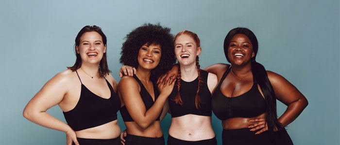 Four women showing different body types
