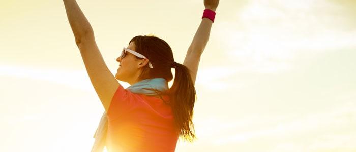 Woman celebrating reaching her goals