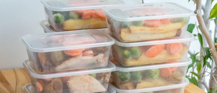 Stacks of pre-prepared food in tupperware boxes