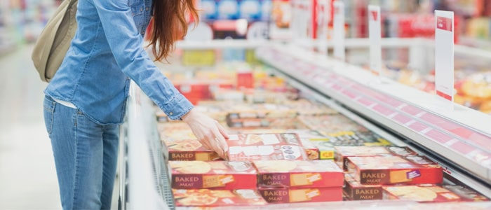 woman shopping for frozen foods at the supermarket