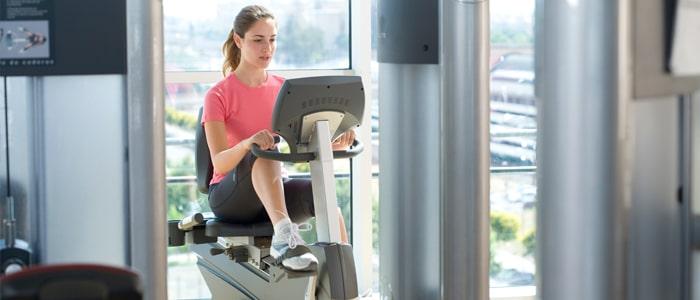 Woman exercising on a recumbent exercise bike