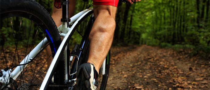 man cycling in the woods