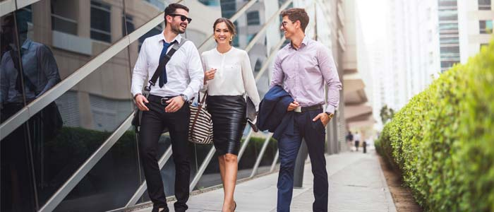 three people walking to work together