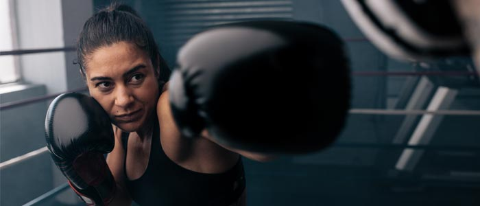 Woman boxing in a ring