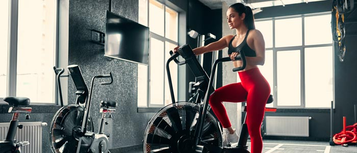 woman on an assault bike in a gym